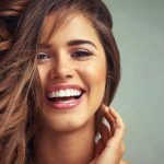 Como aprender a sonreír para las fotos